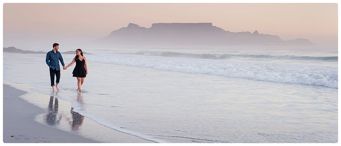 secret proposal photography on Bloubergstrand beach table mountain backdrop